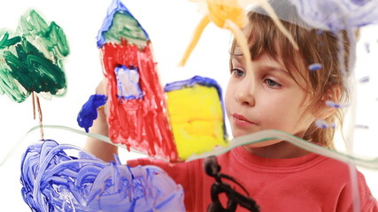 Little girl paint window house in picture on glass