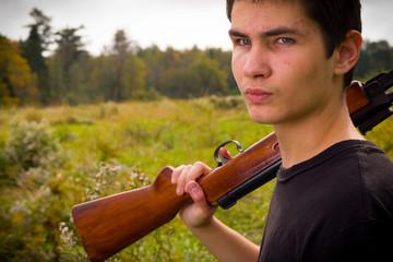 Teenager with gun