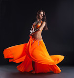 Fototapety beauty dancer posing in traditional orange costume