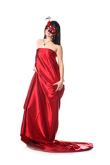 Woman wearing red dress and a mask