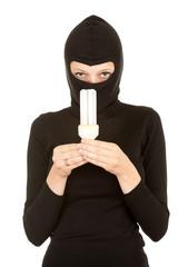 female thief in balaclava and light bulb