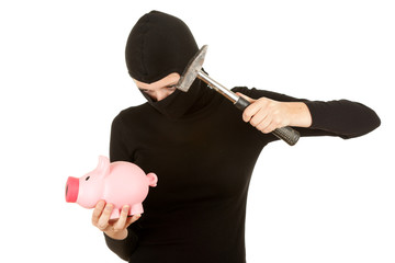 female thief with hammer trying broke piggy bank