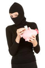 female thief with piggy bank