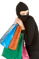 thief in black balaclava with stolen shopping bags