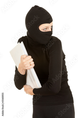female thief in black clothes and balaclava steal documents.