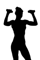 A silhouette of a young attractive woman exercising with dumbbel