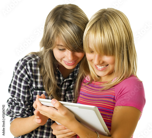 Teenage girls using touchpad. PC tablet
