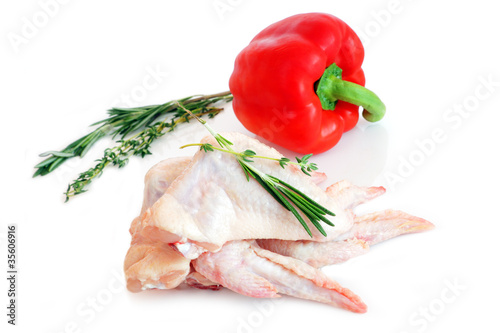 raw chicken wings with rosemary and red pepper