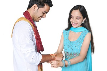 Sister tying Rakhi on her brother's wrist on Rakshabandhan