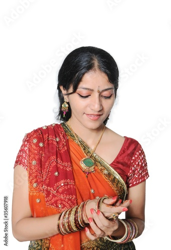 Indian girl getting ready for party and wearing bangles.