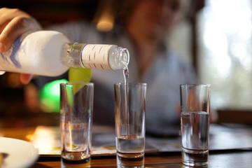 Man pouring vodka