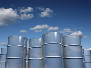 Steel barrels with sky background