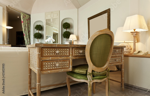 interior luxury apartment, comfortable suite, wooden desk