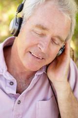 Senior man with headphone