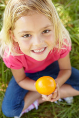 Portrait of happy girl with orange