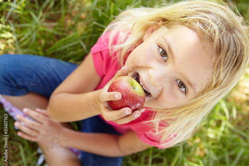 Portrait of happy girl with apple