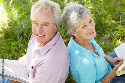 Portrait of senior couple reading