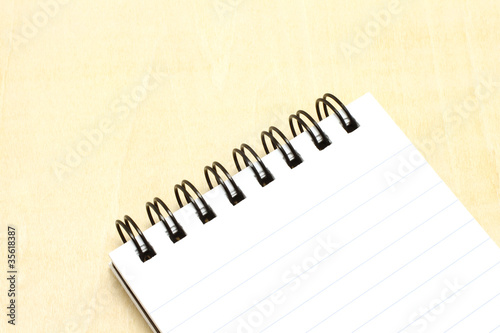 Open notepad close-up on a wooden background