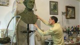 Sculptor D.Petrov molds bust of commander A.Suvorov