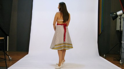 young woman have photo session in studio