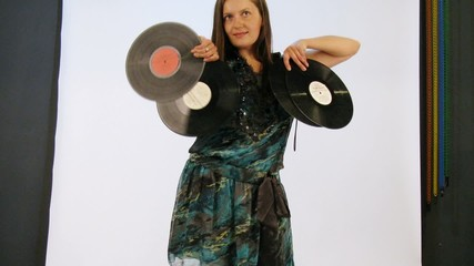 Young woman have photo session with vinyls in studio