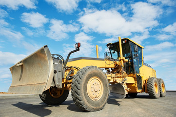 road grader bulldozer