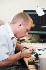 worker soldering microchip scheme
