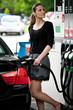 woman refuel car