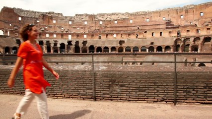 Woman walk along border of one of Colosseum levels
