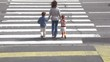 Mother and children, cross road at pedestrian crossing