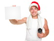 Christmas fitness man showing gift card