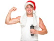 Christmas healthy exercise man showing muscles