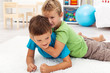 Kids wrestling on the floor
