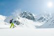 Snowshoeing - female trekking in snow racket