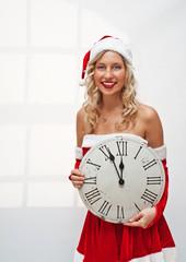 Santa girl with wall clock