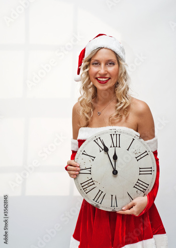 Santa girl with wall clock