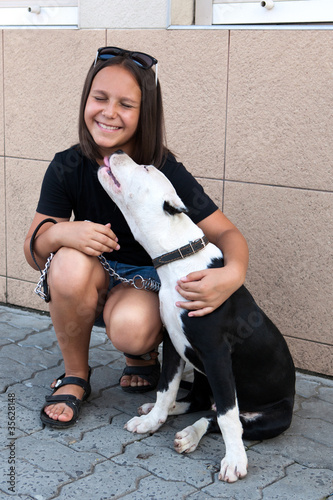 happy girl with her four-legged friend