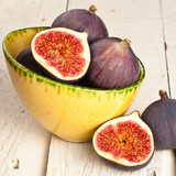 Whole and halved figs in a bowl