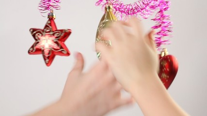Childrens hands touches christmas-tree decoration