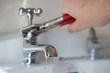Leinwandbild Motiv Plumber vs Leaking Faucet