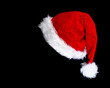Leinwandbild Motiv santa's hat isolated on black background