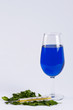 A glass filled with blue substance and a thermometer #2