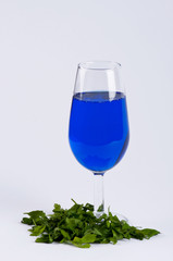 A glass filled with blue substance