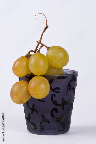 A bunch of grapes in a small cup #5