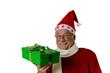 Weihnachtsmann überreicht ein Weihnachtsgeschenk