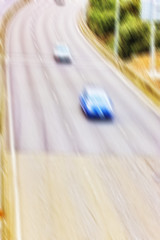 A Motion blurred vehicle in  high speed