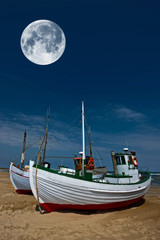 a photo of moonlight, fisher boat and the ocean