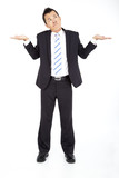 Young businessman shrugging