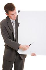 Man holding a white board.