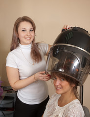 hairdresser working with hair dryer